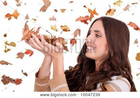 Beautiful  Woman Holding Autumn Leaves