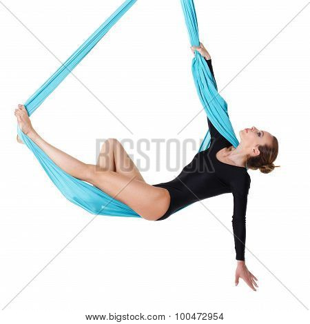 Woman Hanging In Aerial Silk
