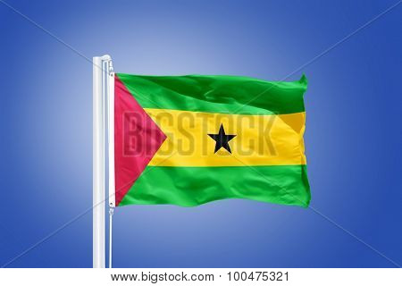 Flag of Sao Tome and Principe flying against a blue sky.