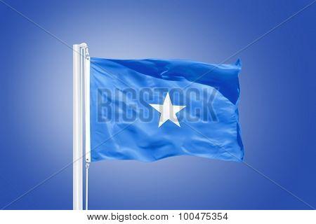 Flag of Somalia flying against a blue sky.