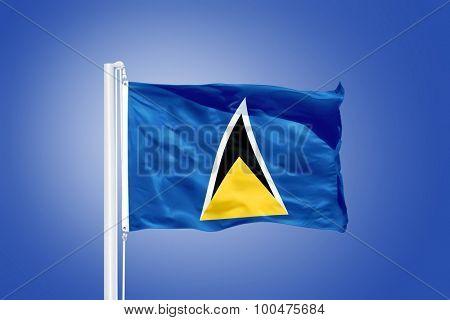 Flag of Saint Lucia flying against a blue sky.