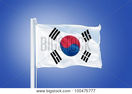 Flag of South Korea flying against a blue sky.