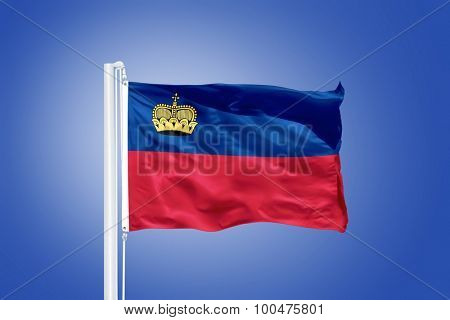 Flag of Liechtenstein flying against a blue sky.