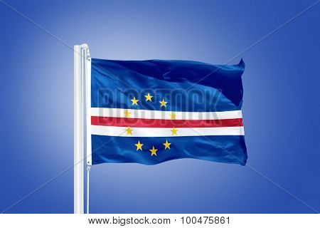 Flag of Cape Verde flying against a blue sky.