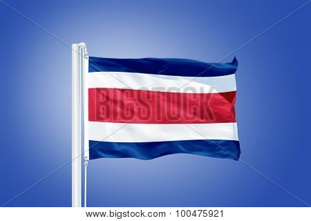 Flag of Costa Rica flying against a blue sky.