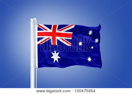 Flag of Australia flying against a blue sky.