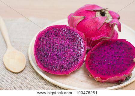 Fresh Dragon Fruit On Wooden Bowl