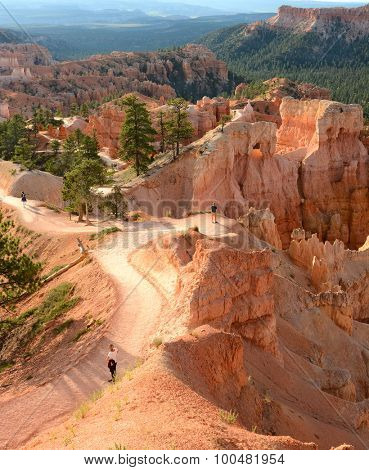 BRYCE CANYON, UTAH - AUGUST 17, 2015: Hikers on the Queens Garden Trail in the Amphitheater area of Bryce Canyon National Park, Utah.