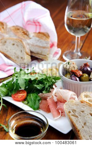 Romantic dinner for two; italian antipasto platter with parma ham, rocket, olives, baguette and wine