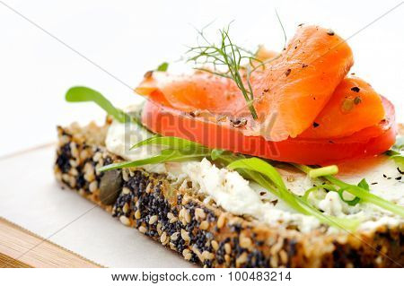 Smoked salmon and salad on a slice of toasted wholewheat bread, a light meal option