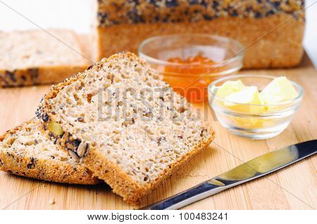 Slices of wholemeal bread with butter and jam, full of vital vitamins and fibre