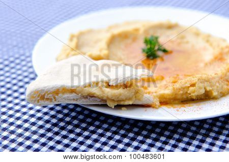 Plate with hummus dip and pita bread, a common tapas or starter dish in middle eastern cuisine
