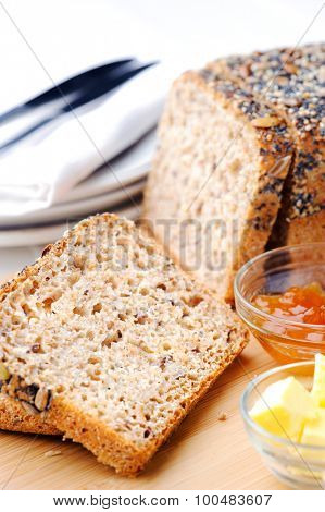 Sliced seeded bread with butter and jam, full of vital vitamins and fibre
