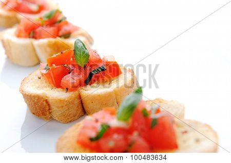 Italian bruschetta; sliced baguette topped with a mixture of chopped tomato, garlic and basil