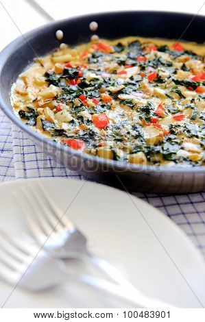 Ready to serve vegetable frittata cooked and served in a frying pan