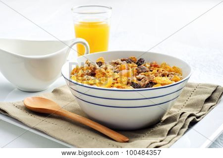 Serving of a nutritious bowl of cereal and orange juice