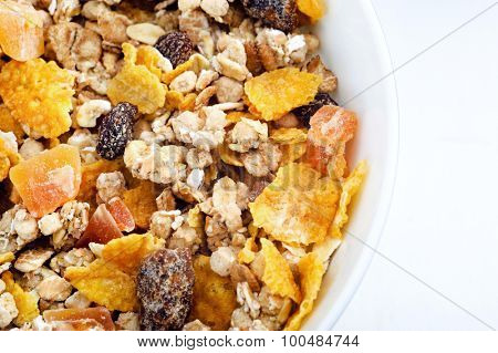 Macro shot of healthy cereal with oats, cornflakes and dried fruit