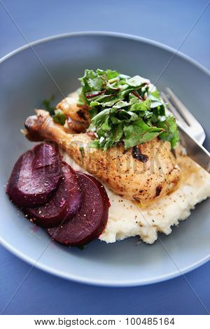 Roast chicken leg with greens spinach, beetroot and mashed potato as a healthy meal