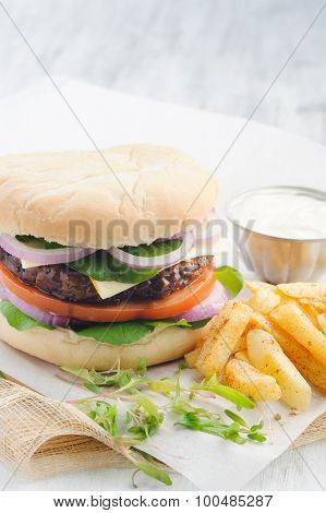 Classic burger with bbq beef patty chips french fries