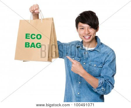 Man finger point to shopping bag for showing phrase of eco bag