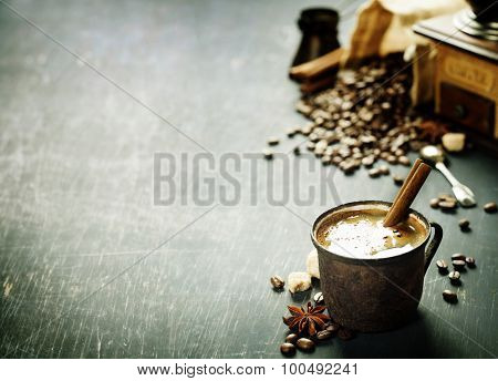 Old coffee cup and mill on dark rustic  background