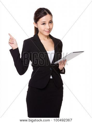 Asian businesswoman use of the digital tablet and finger point up