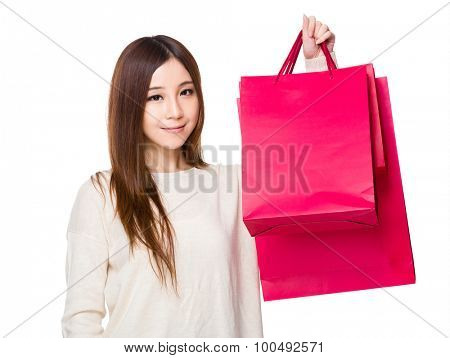 Asian young woman hold with shopping bag