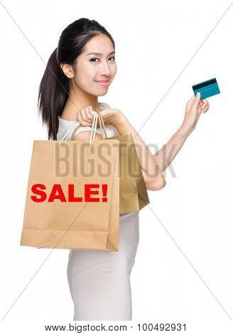 Woman with credit card and holding shopping bag for showing a word sale!