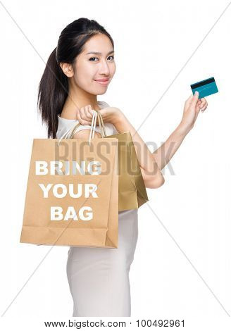 Woman with credit card and holding shopping bag for showing bring your bag