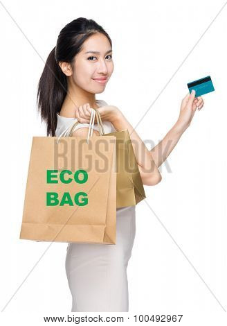 Woman with credit card and holding shopping bag for showing eco bag