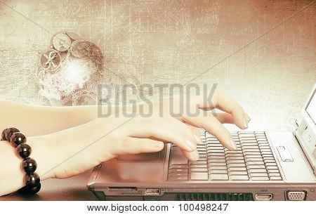 Close up of female hands typing on laptop keyboard