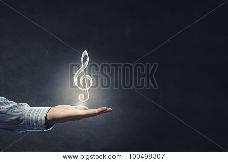 Close up of male hand giving note music