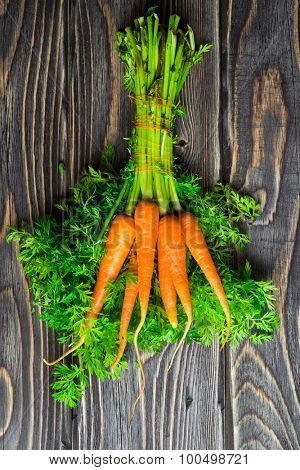 Fresh Organic Carrots on wooden rustic background