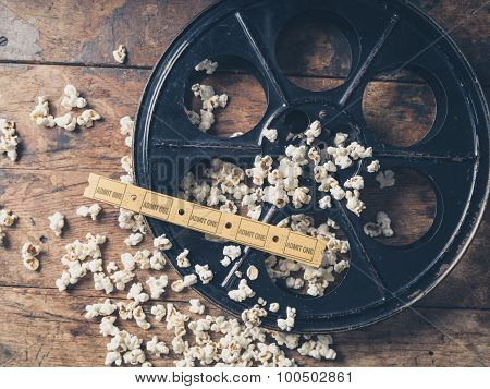 Film Reel With Popcorn And Tickets