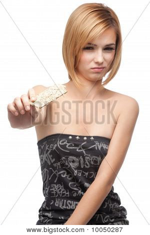 Young Woman Tasting Healthy Bread And Rejecting It