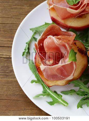 Italian appetizer grilled peaches with parma ham