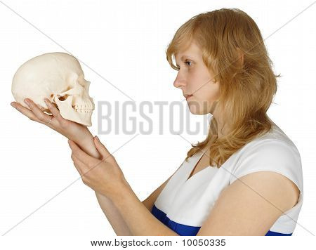 Woman Examines A Human Skull On White