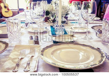 Dining table is set for a holiday dinner