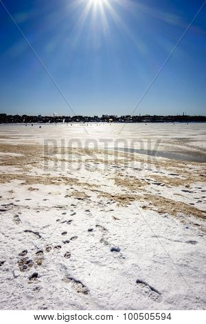 Fishermen on the frozen Volga River in Kostroma, Russia on a bright sunny day