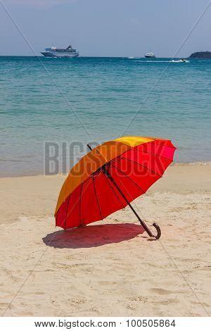 Orange Umbrella On The Beach