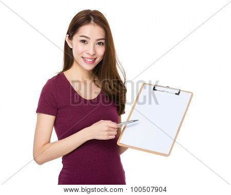 Asian young woman with pen point to clipboard