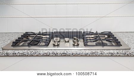 Stainless Steel Cooktop On Granite Countertop