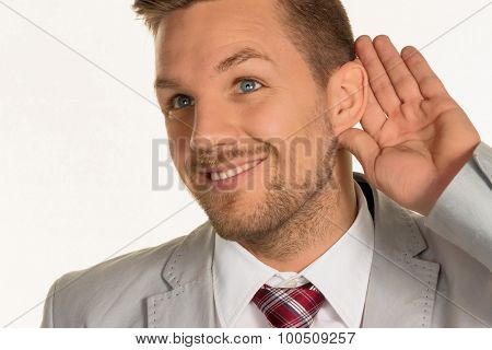 a man (business owner or manager) holds his hand to his ear