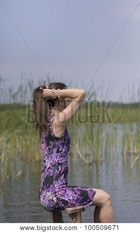 Woman On A Lake Shore