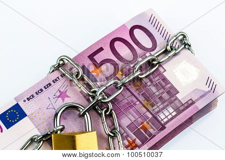 euro notes with chain and padlock. symbolic photo for security and inflation.
