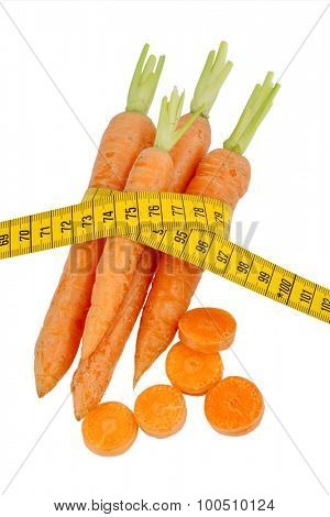 organically grown carrots with tape measure. fresh vegetables and fruits is always healthy. symbolic photo for healthy diet.