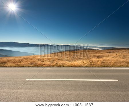 Side View Of Empty Highway In Mountain Range