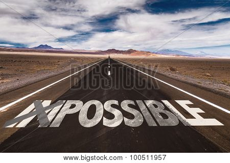 Impossible/Possible written on desert road