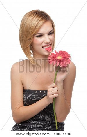 Portrait Of A Young Woman, Frowning And Biting On A Flower's Petals