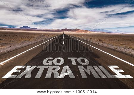 Go To Extra Mile written on desert road